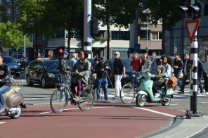 Stuart getting the shot in a crowded Amsterdam street.
